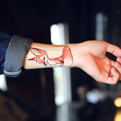 Faux tatouage renard assis